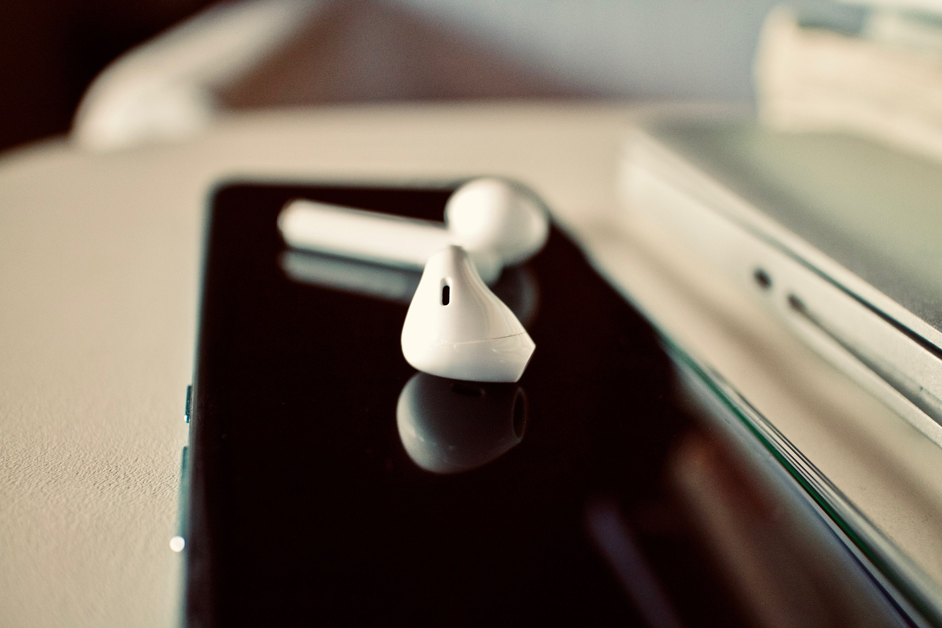 Airpod headphone on cell phone.